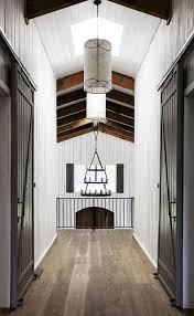 dramatic sliding doors separate. Neutral Painted Walls, Timber Floors, Sliding Barn Style Interior Doors Dramatic Separate A