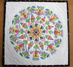 tinted with crayons! I gotta try this. | Quilting Inspiration ... & Using the crayon technique, with the addition of buttons and echo quilting,  this is the first of 3 mandala quilts that I plan to do. Adamdwight.com