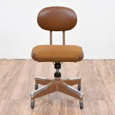 metal office chairs. this retro office chair is featured in an industrial brown and stainless steel metal with a chairs