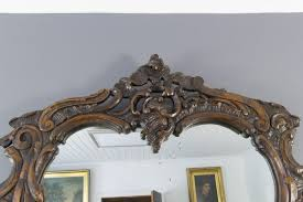 rococo style carved wood dark brown