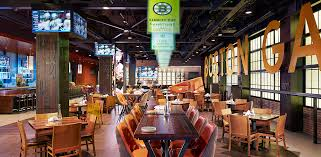 the space features the original boston garden marquee steel plated retired jersey numbers are affixed to the structural columnetallic accents