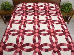 Double Wedding Ring Quilt -- splendid well made Amish Quilts from ... & Rose and Cream Double Wedding Ring Quilt Photo 1 ... Adamdwight.com
