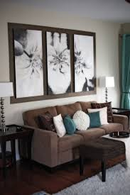 peaceful brown living room with turquoise pillows and draperies