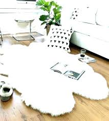 area rugs sheep rug white sheepskin faux fur ivory large furniture row costco s exterior paint grey sheepskin rug