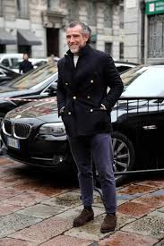 dress in a black pea coat and navy chinos for a dapper casual get up