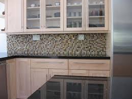 pictures of kitchen oceanside tile backsplash installation and black absolute granite countertops iridescent oceanside glass tiles offer everchanging