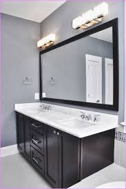 lighting over bathroom mirror. Bathroom Lighting Over Mirror Chrome Shelves Freestanding Corner Tub And Also Lovely Wall Bench Kitchen Table With Storage