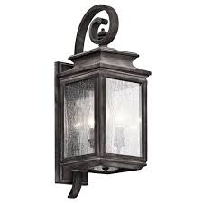 there is a taste of flair in this traditional 3 light outdoor wall fixture from the wiscombe park collection with details reminiscent of old