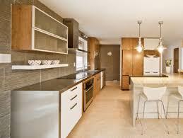 stainless steel countertop wrapped around kitchen cabinets modern kitchen