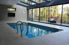 residential indoor lap pool. This Continuous Loop Of Flowing Water Spans The Entire Width Pool, Creating A \u201cwall Water\u201d Similar To River Current. Residential Indoor Lap Pool
