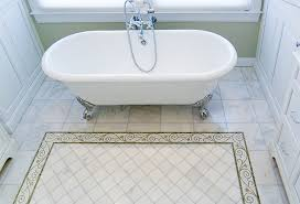 clawfoot tub with custom marble tile floor rug