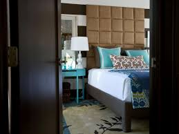 contemporary master bedroom with cushion headboard