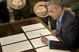 oval office july 2015. us president barack obama signs bills declaring three new national monuments in the oval office of july 2015