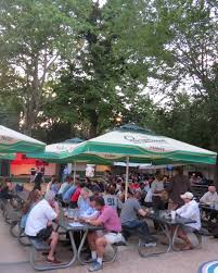 a crowd gathers at the bohemian hall beer garden for an evening of karaoke last