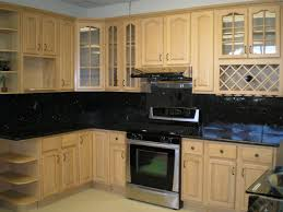cream kitchen cabinets with black countertops. Interior. . White Kitchen Wall Paint Combined By Brown Wooden Cabinet Having Black Countertop Cream Cabinets With Countertops