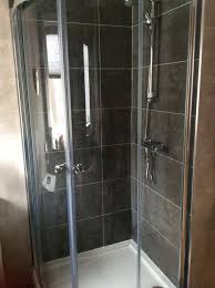 quad shower enclosure and tray very good condition stainless steel and glass measures 800mmx760mm