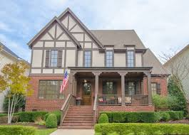 Traditional two-story mixed siding exterior home idea in Nashville