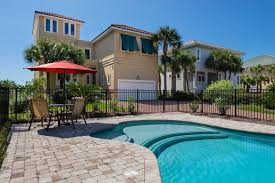 the front of the house featuring the pool