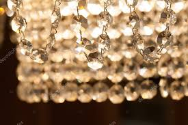 vintage style crystal chandelier lamp with hanging pendants macro view soft focus stock