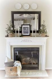Winter mantel ideas love the mercury candlesticks!