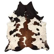 black and brown spotted cowhide rug