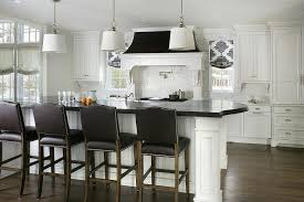 curved black island countertop with black camelback counter stools