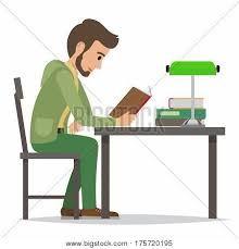 young man reading textbook in library student seating at the table with open book in