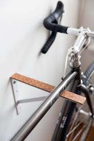 Joe made the bike racks from simple, inexpensive shelf brackets and thick  pieces of cork