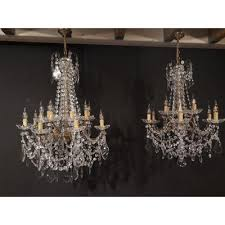 pair of large antique chandeliers with crystal bronze pendants