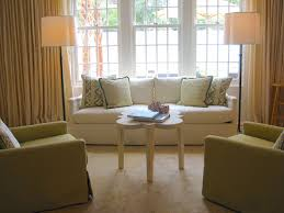 to your left is a more formal seating area with a sofa flanked by two floor lamps circa lighting s simple floor lamps in bronze with silk scalloped shades