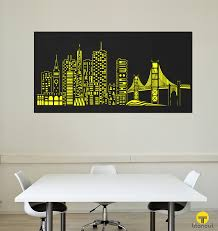 laser cut metal panel with san francisco cityscape pattern on a white wall behind