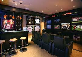 This is one of the most common basement bar designs. The men need their own  hang out space where they can enjoy a good football or basketball game  while ...