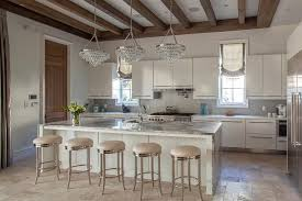 gray marble waterfall island countertop with bling chandeliers