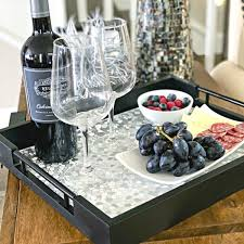 Your coffee table is such an important part of your living room, so it's important it is designed to the nines. Black Decorative Tray With Handles And Silver Placemat Coffee Table Fit Strong Healthy