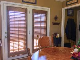 these beautiful stained wood shutters are a stunning addition to french doors
