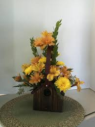 Casual Picture Of Accessories For Dining Table Decoration Using Unique Tall  Yellow Flower Centerpiece Including Unique Wooden Bird House Flower Vase
