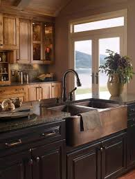 kitchen island with copper farm sink