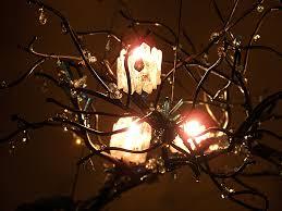 floating fantasy branch chandelier detail embellished w rock crystals semi precious stones and swarovski crystal