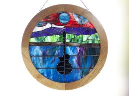 round stained glass frame made of oak features hanging hardware