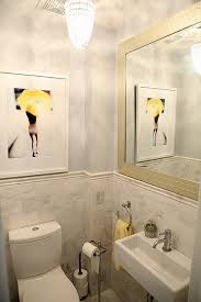 bathroom paint yellow. gorgeous yellow and gray bathroom with a pop of yellow! blue walls paint color, marble tiles backsplash, wall-mount modern sink, crystal chandelier
