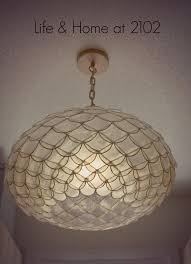 chose this capiz scalloped chandelier from serena lily among the lighting options i was contemplating on here