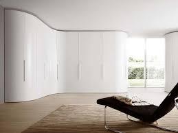 curvy shaped modern white lacquered wardrobe closet design