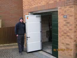 sectional door with wicket door