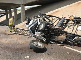 Local News: Pickup, camper crashes through overpass guard rail on I ...