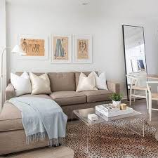 taupe linen sofa with chaise lounge and blue throw blanket