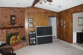 inspiring tips on paint wood paneling ideas awesome paint wood paneling with brick fireplace and