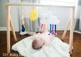 diy baby gym tutorial with free patterns for the hanging toys rainbow cloud sun