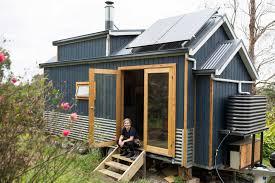 tiny house news. Sarah Smethurst Sits On The Stairs Ouside Her Tiny House. House News S