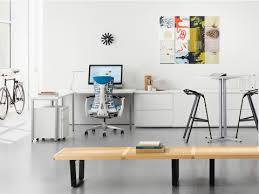 a café height everywhere table provides collaboration space for a workstation that also features a