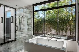 contemporary bali inspired bathroom gray tub glass shower mosaic tile wall large windows in black frames
